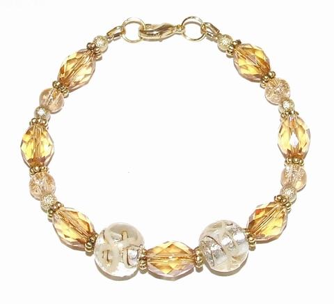 Armband goudkleurig 90775   Armband glas/kristal/metaal