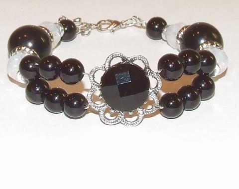 Armband zwart 9516 | Zwarte armband met strass bloem