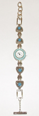 Horloge met blauwe steentjes