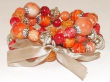Armband 67933   Armband 3 rijen kralen oranje/rood