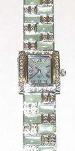Horloge met groene steentjes en heldere strass